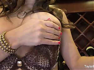 busty dark haired Taylor Vixen teases the camera