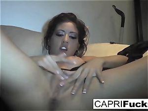 Capri Cavanni play with her moist twat