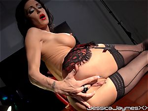 insatiable brown-haired Jessica Jaymes thumbs her appetizing pussy pie in her office