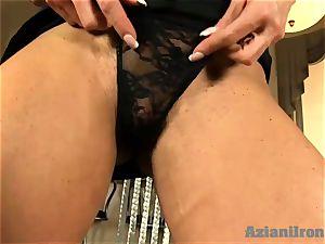 Buff woman glides dark-hued dildo in her moist cooch