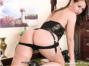 dark-haired secretary drains on desk in underwear and nylons