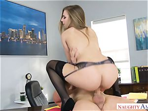 Sydney Cole riding on a stiffy in the office