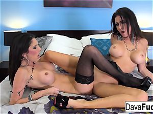 girl-on-girl lovemaking with Jessica Jaymes on bed with blue wall