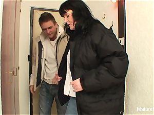 huge-titted black-haired grandma screws on the floor