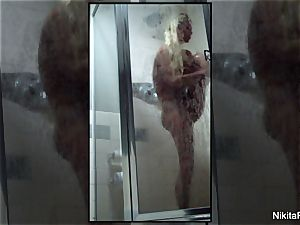 Home video of Nikita Von James taking a douche