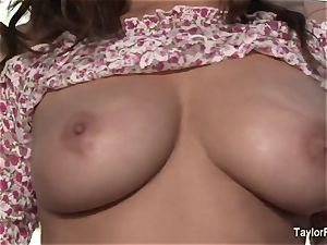black-haired beauty Taylor plays with her large boobies