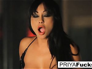 big-titted Priya Rai rides the sybian at the unclothe club